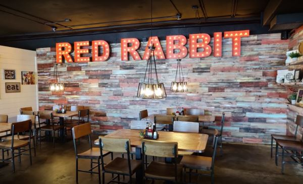 Photo of neon sign saying Rabbit Grill