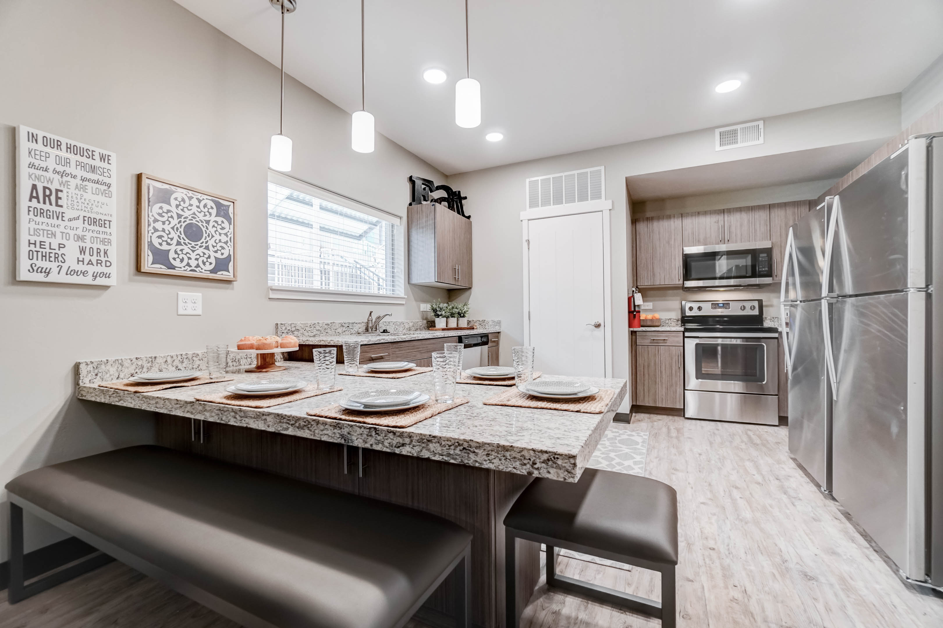 With two full-size refrigerators, granite countertops, lots of beautiful cabinets, stainless steel appliances, and a garbage disposal, the kitchen has everything you need!