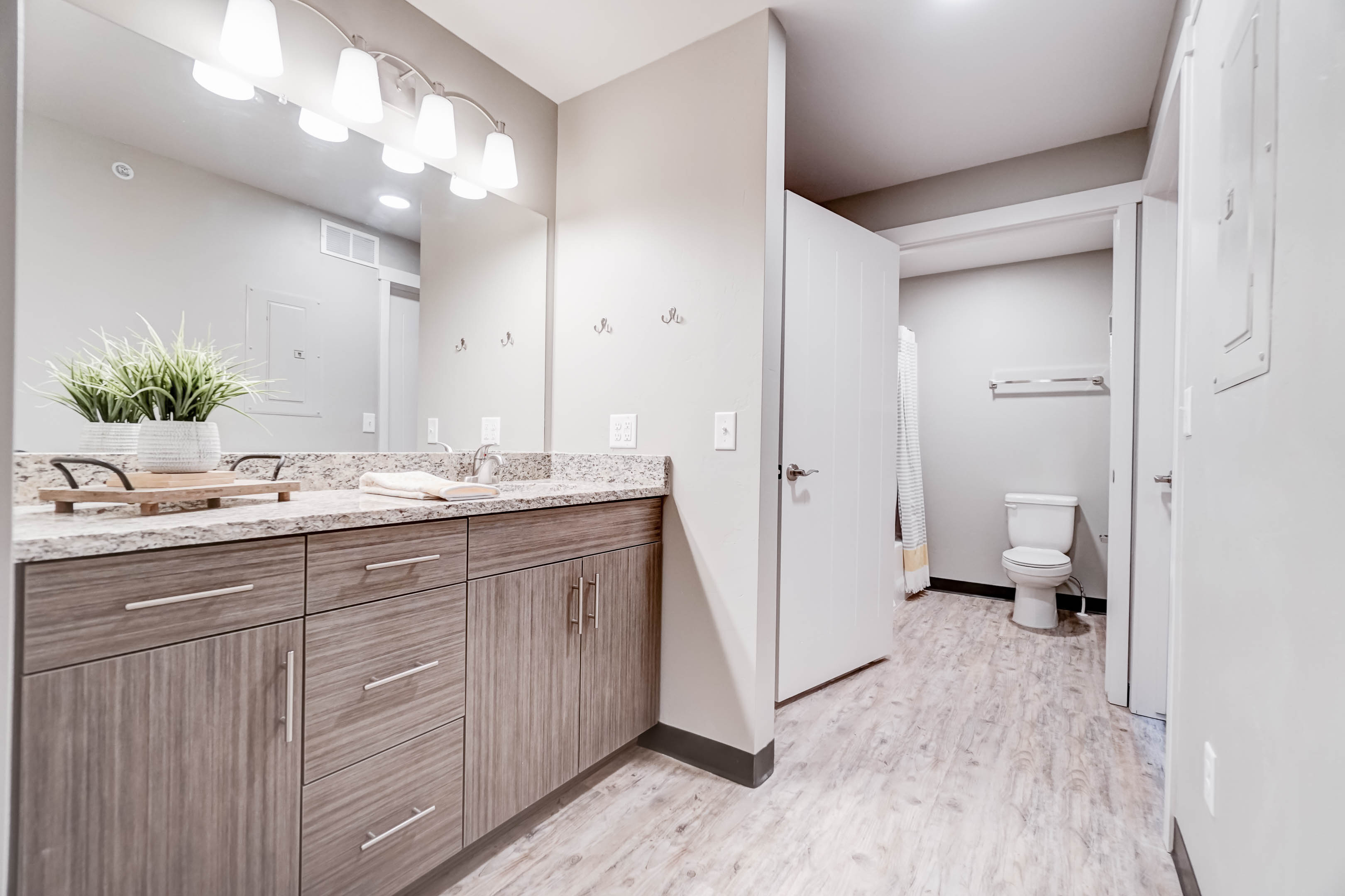 Vanities and bathrooms are separate so someone can be showering while others are getting ready.  Between the two vanities there are more drawers than tenants!